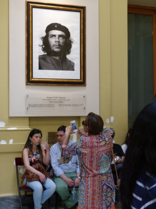 A visitor takes a picture of a picture of Che Guevara