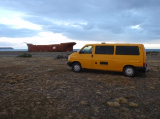 Parked for the night on a beach next to a huge wreck