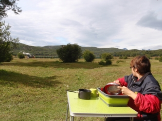 Passing spectators for breakfast washing up camped by the Tierra del Fuego railway