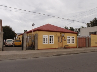 A typical building in Punta Arenas - this one our Hostal while we wait to get the rear suspension on the van repaired
