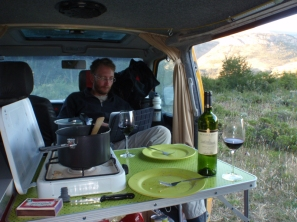A van life scene - typical evening in the van on the road (when it's not too windy to have the door open!)