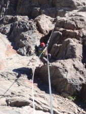 Becca launching herself onto the Tyrolean traverse (a cable to cross the small gorge below) for the first crossing