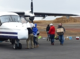 Loading up the plane, under the pilot's careful direction