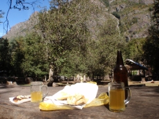 Enjoying homemade beer at the refugio with our packed lunch of empanadas