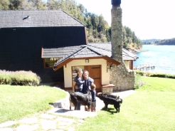 The lovely Nachmans in front of their house by the lake
