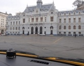 The grandeur of the naval building by the front is in stark contrast to the chaos on the hills above!