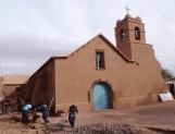 The lovely adobe church in the centre was being restored while we were there