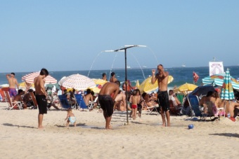 Typical beach scene - showers are set up at regular intervals along the beach