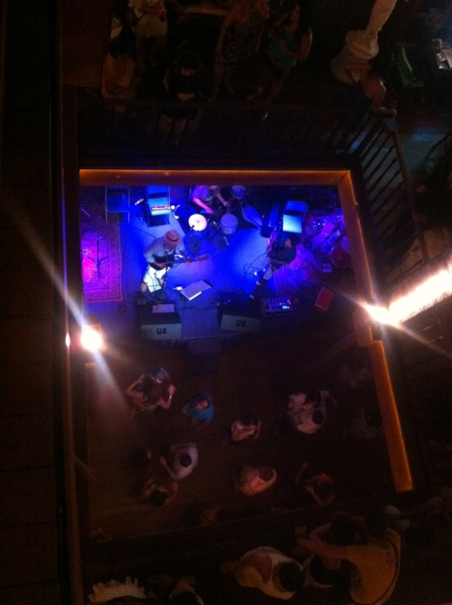 Looking down from the top floor onto the stage at Scenarium