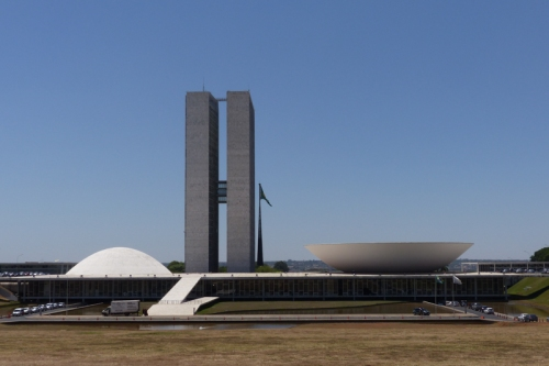 The National Congress buildings, with domed Senate building on the left, the Parliament office tower in the center, and the bowl-shaped Chamber of the Deputies on the right