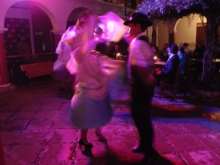 A dance display in the courtyard of a restaurant