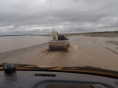 To be faced with more burst riverbanks - this time the boatman hopped into the back of the little pickup and lead us through the shallowest line