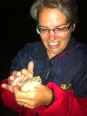 Becca befriends a frog by the gateway to the campsite