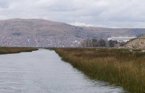Looking back down the reed channel at our enormous hotel on the right (can they ever fill it?) with Puno behind