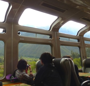 Enjoying the viewing windows in the tourist train to Machu Picchu
