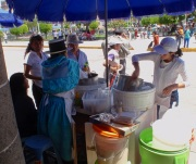 Homemade frozen yogurt on sale in the square, kept frozen by being spun by hand on ice