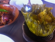 An hoja - parcel of rice and meats cooked in a leaf (with the rich duck dish to the side)