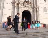 Guests gathering outside for a wedding
