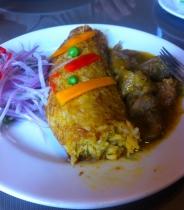 Tacu tacu with cabrito (goat stew)