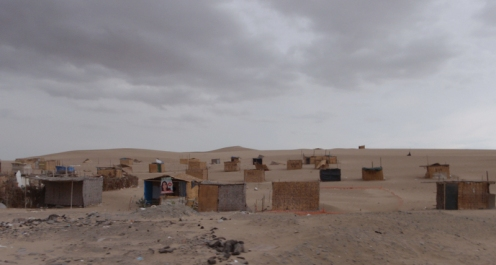 ...with small shacks occupying the marked out rectangular plots in the desert