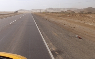 Heading north again - a typical view of the PanAmerican highway through Peru's coastal desert