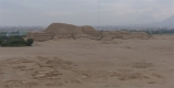 Opposite is the Huaca del Sol, the largest pyramid in the Americas, with the modern city of Trujillo behind