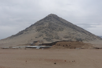 The site of Huaca del Luna in front of a hill thought to be of religious significance. The temples were built to reflect the shape of the hills next to them.