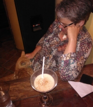 Relaxing with an algarrobina cocktail and another cat in Mancora
