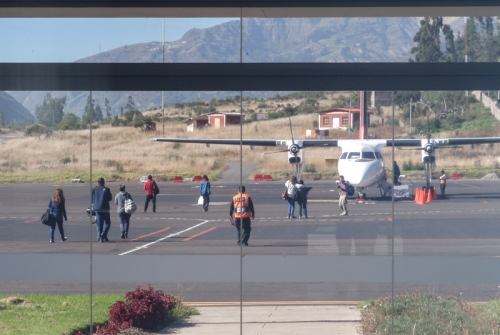 Becca walking out to board the little flight from Huaraz to get a flight home from Lima