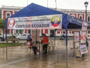 """Contigo Ecuador"" - ""with you Ecuador"": They were there to raise money following the big earthquake that had recently hit the coast of northern Ecuador"