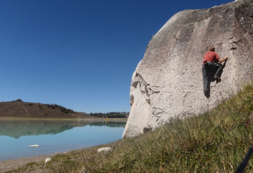 Bouldering on his own at Lago Keushu