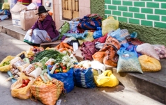 An old lady selling vegetables on the streets of Huaraz