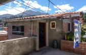 "Our little ""penthouse"" rental apartment in a suburb of Huaraz near the garage didn't look too promising on the outside!"