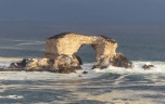 This sea arch off the coast of Antofagasta, Chile, doesn't have a dark rocky surface...